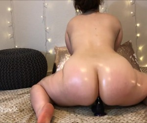 Oiled Big Tits and Ass Riding a Huge Dildo